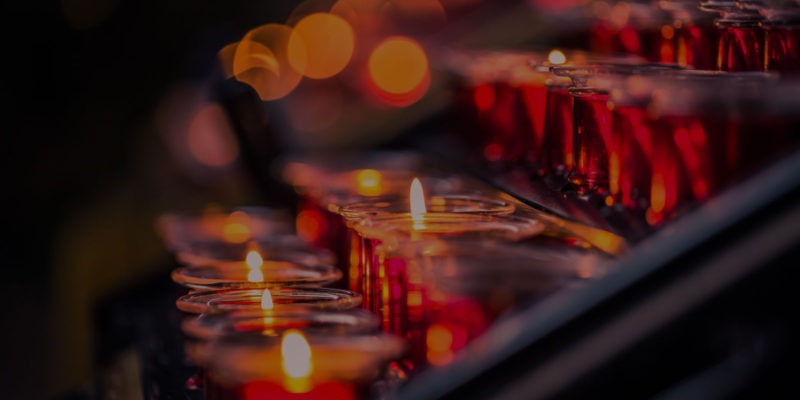 Lit church candles image